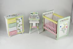 """A three-piece green, yellow and pink clown themed nursery set, with handpainted details. Includes crib, high chair and dresser. Measurements: Crib - 4 1/4"""" x 2 1/2"""" 3 3/4"""" High Chair - 3 3/4"""" x 2"""" x 2"""