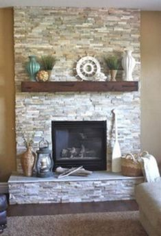 Corner faux fireplace faux fireplace stand fireplace mantle stand full size of fireplace remodel ideas on Stone Fireplace Mantel, Stacked Stone Fireplaces, Fireplace Redo, Rustic Fireplaces, Fireplace Remodel, Living Room With Fireplace, Fireplace Surrounds, Fireplace Ideas, Simple Fireplace