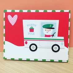 """Christmas card using die cut pieces from Doodlebug 's odds&ends """"here comes santa claus"""". The base card uses the boxed cards set from American Crafts """"North Pole"""". They match so well!"""