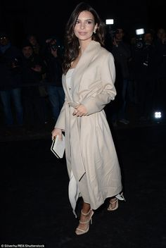Cream dream: Emily Ratajkowski, 25, chose to cover up her famous figure on Monday night as she headed to the Juventus Black and White and More Party in Milan