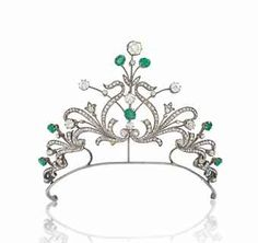 LATE 19TH CENTURY EMERALD AND DIAMOND TIARA/NECKLACE    circa 1890, with diamond-set back chain for wearing as a necklace together with further mounts to break down into a ring, brooch, earrings and bracelet. (Christie's)
