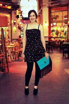 This is a unique Vintage strapless black dress with colorful polka dots