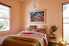 "The master bedroom is painted in Dulux's ""Peach Cascade."""