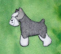 felt schnauzer  BUT ... shorten the legs ... beefed up a bit ... we could make a Scottie!