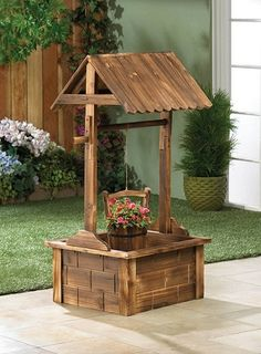 A stunning showcase your favorite summer blooms! This absolutely charming outdoor planter features fir wood construction, a squared wishing well pavilion, and a hanging metal-banded wooden bucket that awaits the plant of your choice.  Fir wood.