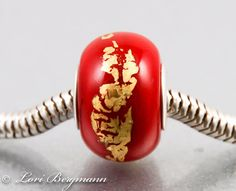 Red and 23K Gold Leaf Handmade Lampwork European Charm Bead with Sterling Core by LoriBergmann on Etsy