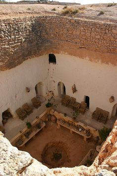 Underground House, Gharyan, Libya -  So picture a tree or better yet, several, coming up out of this central courtyard, and add in platforms and tree house elements above...