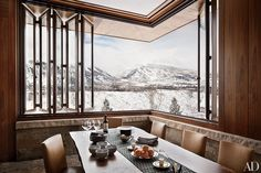 Rustic Dining Room by Studio Sofield and Studio B Architects in Aspen, Colorado; Aspen, Colorado The dining room, featuring a retractable Tischler window that looks out on Aspen Mountain, is anchored by a BDDW walnut-slab table. Architectural Digest, Montana Homes, Colorado Homes, Küchen Design, House Design, Design Firms, Rustic Design, Garden Design, Aspen Ski
