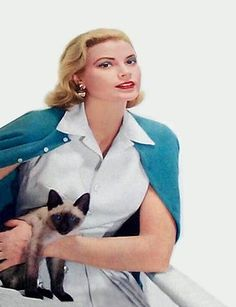 Grace Kelly (November 12, 1929-September 14, 1982) American actress who married the prince of Monaco with Siamese Cat