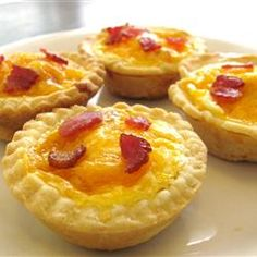 "Bacon and Egg Breakfast Tarts Allrecipes.com  ""Perfect selection for a brunch, but also convenient enough for serving on a weekday. Instead of Canadian bacon, try using 1/2 cup diced cooked ham or 1/2 cup crumbled cooked bacon. Place 2 tablespoons of meat into each pastry cup.""  wedding brunch recipe, breakfast recipe"