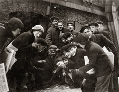 """February 1910. """"A crap game in the paper alley. Rochester, New York."""""""