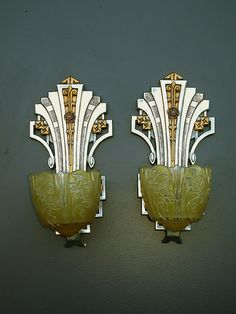♥LIKE: Art Deco slip shade sconces.    pair of vintage slip shade wall light fixtures from the late 20s and early 30s manufactured by the Lincoln Co. Restored to their original color scheme of highly polished aluminum and sunset golden.