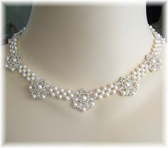 Ivory Swarovski Pearls, silver seed beads and clear Swarovski Austrian Crystal.