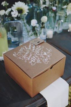 Calligraphy on dinner boxes. http://www.weddingchicks.com/2014/01/13/eclectic-midwest-wedding/