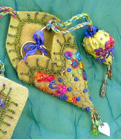 Nice blog with wet felt used as a base for stitchwork like this scissor case Chatelaine