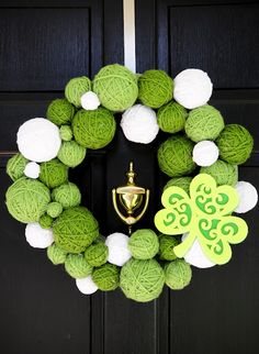 Ball Wreath. I made with balloons, school glue/water, and yarn. Water noodle, tape, green material for the actual wreath. Ch'ree St. Patty's day success.
