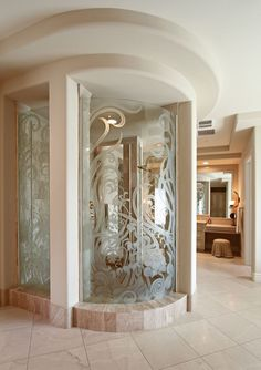 What a shower! Love the etched glass enclosure!