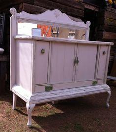 Repurposed stereo cabinet, headboard and chair legs = buffet Trash Interiors Abilene Texas