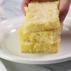 Lemon brownies AKA lemon blondies - Super soft and moist bars topped with the most delicious lemon glaze. The perfect summer dessert that you'll be making over and over again! Lemon Dessert Recipes, Lemon Recipes, Greek Recipes, Easter Recipes, Brownie Recipes, Cake Recipes, Kid Desserts, Food Cakes, Let Them Eat Cake