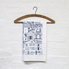 Coastal Cottages tea towel by jessicahogarth on Etsy, £7.00  I've pinned this not for the towel itself but for the idea of using vintage hangers to display/hang my dishtowels.