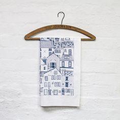 This highly illustrative Coastal Cottages tea towel showcases the surface pattern design skills of North Yorkshire based illustrator Jessica