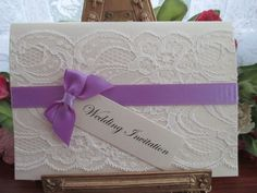 S0438I A6 IVORY LACE WEDDING INVIATION HYACINTH PURPLE RIBBON Available from www.vintagelaceweddingcards.co.uk