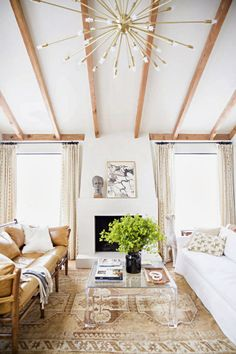 love the custom sputnik chandalier and wood beams on ceiling