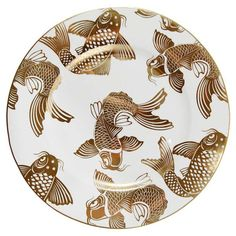 Featuring a charming fish print and bold border, this lovely plate adds elegant appeal to your tablescape.  Product: Set of 4 sa...