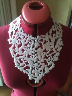 Artist Kevin ball made this necklace using melted peices of InstaMorph and some magnets.