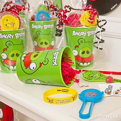 Angry Birds Party Cups make the best reusable goodie bags! Stuff them with treats or additional favors. Click the pic for more Angry Birds party ideas!
