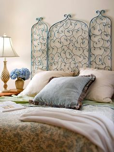 I have a BEAUTIFUL fireplace screen - this is a nice idea. Cozy up your bedroom by unfolding a fireplace screen and hanging it on the wall behind your bed as a headboard. For an antique look, use spray paint to cover the screen in blue. After it?s dry, dip a sponge in bronze paint and wipe a light coat on the screen. Repeat with copper paint. Finish with a clear spray-on sealant.