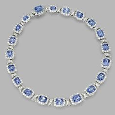 [Oh my!] SAPPHIRE AND DIAMOND NECKLACE Cushion-shaped sapphires weighing 75.02 carats, round diamonds weighing approximately 24.40 carats, mounted in platinum, length 15 1/2 inches.