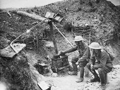 WW1: Two soldiers cooking in a trench at Ovillers with a scrounged stove. July 1916. Note the elaborate arrangement for the chimney in an effort to avoid smoke rising perpendicular to the stove -- a telltale sign for enemy artillery observers.