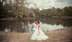We're in love with this picturesque lake view of a bride and groom from Lyndsi Metz Photography! Click the image for more details.