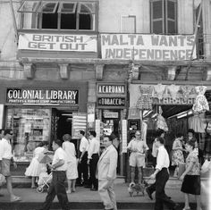 A view of shops with anti-British and pro-Independence signs, possibly on Kings Street, Valetta, Malta   circa 1960-64