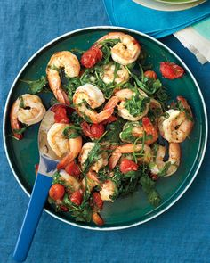 Sauteed Shrimp with Arugula and Tomatoes | Martha Stewart Living - You can serve this quick saute over rice or toss it with your favorite pasta.