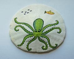 we all live in a yellow submarine. Octopus Painting, Seashell Painting, Seashell Art, Seashell Crafts, Beach Crafts, Stone Painting, Rock Painting, Painted Sand Dollars, Sand Dollar Art