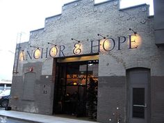 Anchor & Hope - An Urban Oyster Bar in San Francisco from Remodelista Storefront Signage, Shop Signage, Signage Design, Exterior House Colors, Exterior Design, San Francisco Bars, Exterior Signage, Oyster Bar, Brick Building