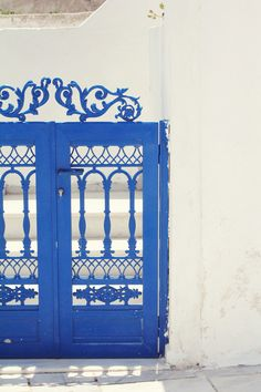 Ornamented blue door in Santorini