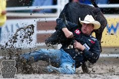 Steer wrestler Todd Suhn of Weatherford, TX competes in the 2011 Calgary Stampede at Stampede Park in Calgary, AB Canada.