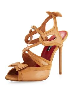 classic nude stiletto - in patent with a KICK!  and a front buckle and a back bow.  yay!