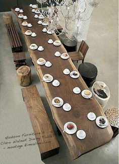 // huge dining table, raw wood, raw edges, benches