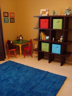 Robot Nursery, A robot room with bright colors.  Modern furniture and fabrics.  This room was done on a budget, but I was really happy with how it turned out.  , Found a bright rug at Ikea that was within my budget. I also got a small table and chairs from a garage sale and spray painted them.  , Nurseries Design