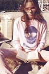 The Wildfox Love Skull Sweater Dress in Bubblegum Sweater is a vintage-inspired gem. Made from a soft cashmere blend, the sweater features a crew neck and gently draped long sleeves and hem. Its sparkle skull design gives it a finishing touch.