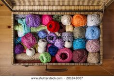 Zenithal view of a messy pile of colorful balls of wool in an old suitcase by Ricard Vaque, via Shutterstock   [www.vaque.com]