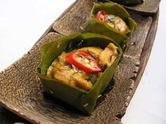 Amok Trei - Coconut Fish Curry Parcels - If there is one item of Cambodian food that incites real passion amongst tourists to Cambodia, it is fish amok (amok trei). The mousseline fish curry steamed in a banana leaf container is one of the few Cambodian foods that consistently strikes a chord with foreigners from everywhere.  - http://aussietaste.recipes/seafood/snapper/amok-trei-coconut-fish-curry-parcels/  -   #recipe