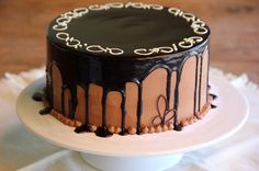 Lovejoy Bakers: Triple Chocolate Cake | Chocolate cake with dark chocolate mousse layers, chocolate butter cream and a chocolate glaze. Adorned with white and dark chocolate decorations.