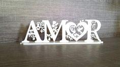LANÇAMENTO!!!! Amor de MDF recortado a laser. Decoração Birds. <br>Palavra decorativa com base. <br>Cor Branca <br> <br>Medidas: <br>7 altura <br>24 comprimento da base <br>5 largura da base <br>MDF de 3mm <br> <br>Atualmente muito usado para decorar mesa de bolo em festas de casamento e noivado. <br> <br>Perfeito também para decorar sua casa ou escritório, para presentear, etc... <br> <br>O prazo para confecção pode variar para mais ou para menos.