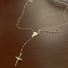 Sterling Silver Rosary Necklace Sterling silver rosary bead necklace! Never worn. Accepting offers! Jewelry Necklaces