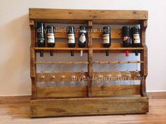 Instructions of how to make a wooden wine rack with pallets - I love this one cuz it can be hung or sit on the floor plus you get extra shelf space with it.